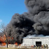 TOMI KEHR | CONTRIBUTED<br /> Flames roll out of Forest River Plant 59 Tuesday afternoon.