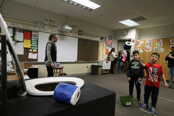 AIMEE AMBROSE | THE GOSHEN NEWS <br /> Maddox Bailey, 7, tosses a roll of TP in the Toilet Bowling activity during the annual Oxbowzaar at Ox Bow Elementary School, 23525 C.R. 45, Saturday.