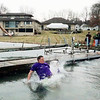 "AIMEE AMBROSE | THE GOSHEN NEWS <br /> (center) Yeager, Elkhart, jumps into Simonton Lake with his group in honor of Yeager's brother, Jeffery ""Jeffro"" Yeager, who died from cancer. The group and others plunged into the icy waters  during the 14th annual Leprechaun Leap outside Re-Pete's Simonton Lake Tavern, 51426 Ind. 19, Saturday as part of a fundraiser to benefit Cancer Resources for Elkhart County."