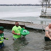 "AIMEE AMBROSE | THE GOSHEN NEWS <br /> Elkhart Police Officer Jim Ballard (shirtless) whoops and shakes off the cold after jumping into Simonton Lake as part of the 14th annual Leprechaun Leap outside Re-Pete's tavern, 51426 Ind. 19, Saturday. Ballard's team, ""The Angry Leprechauns,"" and a host of others plunged into the icy lake as part of a fundraiser to benefit Cancer Resources for Elkhart County."