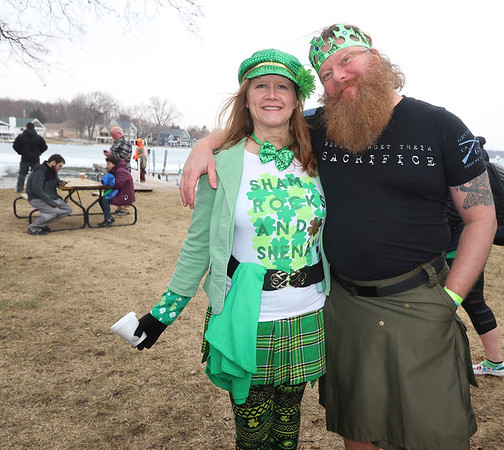AIMEE AMBROSE | THE GOSHEN NEWS <br /> (from left) Monica and Derek Kunz Elkhart, pose near the shore of Simonton Lake during the 14th annual Leprechaun Leap Saturday. Groups jumped into the icy water outside Re-Pete's tavern, 51426 Ind. 19, as part of a fundraiser to benefit Cancer Resources for Elkhart County.