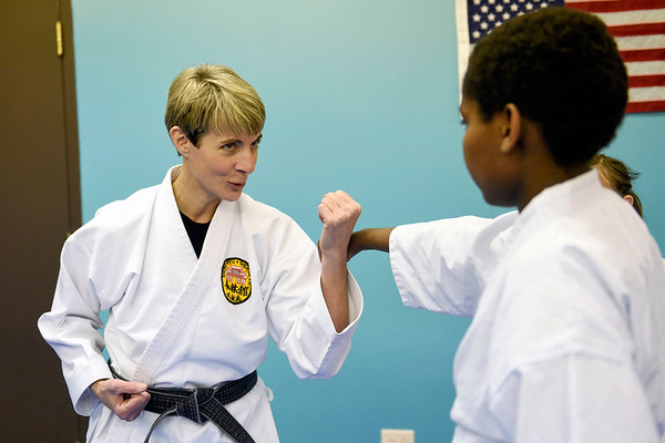 BEN MIKESELL | THE GOSHEN NEWS<br /> Instructor Darlene Guthrie teaches Eann Gatuna, 12, Elkhart, how to block during class Tuesday evening at the Elkhart Okinawa Karate Club.