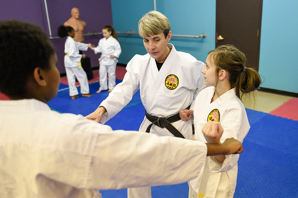 BEN MIKESELL | THE GOSHEN NEWS<br /> Instructor Darlene Guthrie teaches Megan Miller, 11, Elkhart, how to block during class Tuesday evening at the Elkhart Okinawa Karate Club.