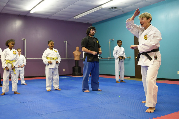 BEN MIKESELL | THE GOSHEN NEWS<br /> Darlene Guthrie instructs her class how to efficiently block during lessons Tuesday evening at the Elkhart Okinawa Karate Club.