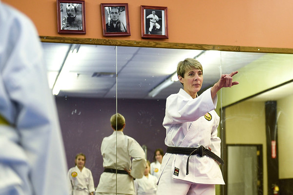 BEN MIKESELL | THE GOSHEN NEWS<br /> Darlene Guthrie leads her class Tuesday evening at the Elkhart Okinawa Karate Club.