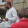 BEN MIKESELL | THE GOSHEN NEWS<br /> Clarence Hogan, youth pastor at Maple City Chapel, leads the group in a prayer of repetance Thursday during the National Day of Prayer service at the Elkhart County Courthouse.