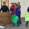 BEN MIKESELL | THE GOSHEN NEWS<br /> Protestors listen to speakers during a rally in the parking lot of Cueramaro Supermarket on Lusher Avenue during a march Wednesday afternoon in Elkhart.