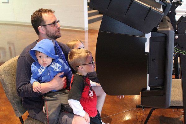 Roger Schneider | The Goshen News<br /> Aaron Gerber casts his vote at Grace Community Church Tuesday morning with the help of some youngsters. With Gerber are, from left, Elam Stoltzfus, 2, Lisa Gerber 3, and Eli Gerber 5.