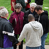 BEN MIKESELL | THE GOSHEN NEWS<br /> People gather to worship in small groups during Thursday's National Day of Prayer in front of the Elkhart County Courthouse.