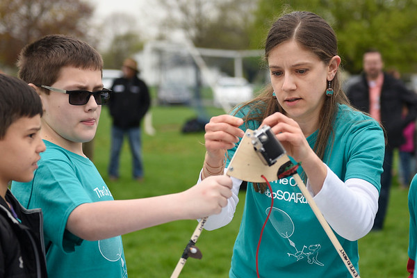 BEN MIKESELL | THE GOSHEN NEWS<br /> Teacher Elizabeth King, right, helps her fourth-grade student Aiden Thornburg adjust the rig, which will be sent up with the weather balloon Friday morning at Ox Bow Elementary School.