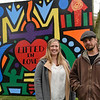 BEN MIKESELL | THE GOSHEN NEWS<br /> Goshen artist Josh Cooper, right, stands with Kari Tarman, with Oaklawn, in front of a mural Cooper painted this month. The mural, commissioned by Oaklawn, will be on display at the Elkhart County Courthouse throughout the month of May for Mental Health Awareness Month.