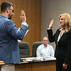 JOHN KLINE | THE GOSHEN NEWS<br /> Goshen Mayor Jeremy Stutsman, left, conducts the swearing-in ceremony for Kristen M. Carich following her hiring as a special police officer with the Goshen Police Department during Monday's Board of Public Works and Safety meeting.