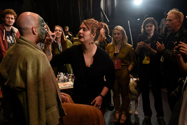 BEN MIKESELL | THE GOSHEN NEWS<br /> Make up artist Sarah Elizabeth, a Goshen native, demonstrates a mask application with the help of her fiancé Mark Ferns during Friday's River Bend Film Festival at Art House in Goshen. Elizabeth has appeared on the SyFy show Face Off and various Netflix series.