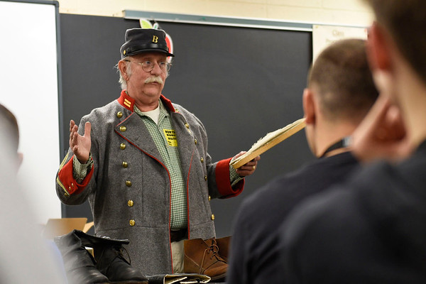 BEN MIKESELL | THE GOSHEN NEWS<br /> Chris Peak, a southern infantry reenactor, explains how early tennis shoes were created by soldiers in the Civil War during a presentation Friday morning at Northridge Middle School.