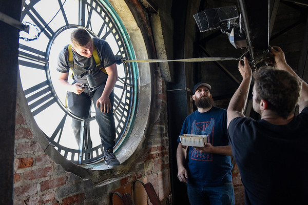 BEN MIKESELL | THE GOSHEN NEWS<br /> The crew from Indianapolis-based Smith's Bell and Clock Service, from left, Jordon Blythe, John Pelance and Nic Clayton work Wednesday morning in the Elkhart County Courthouse clock tower.