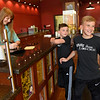 BEN MIKESELL | THE GOSHEN NEWS<br /> Owen Holmes, 9, right, laughs with his brother Tyler, 8, center, as they order more popcorn from Kate Leaman, left, Wednesday afternoon at Shirley's Gourmet Popcorn in Goshen. Owen has been using Shirley's popcorn to raise money for his grandfather, Dan Holmes, who is on the heart transplant list.