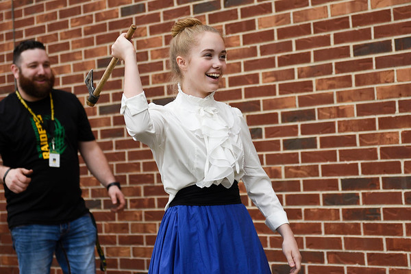 BEN MIKESELL | THE GOSHEN NEWS<br /> Eighth-grader Tess Miller gets ready to toss a tomahawk at a target Friday morning during Civil War day activities at Northridge Middle School.