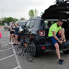 BEN MIKESELL | THE GOSHEN NEWS<br /> Josiah Parker, of Middlebury, straps up his shoes as he gets ready to ride in his first-ever ADEC Ride-A-Bike fundraiser Saturday morning at Northridge High School.