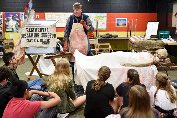 BEN MIKESELL   THE GOSHEN NEWS<br /> Surgeon reenactor Craig Malone explains how medics in the civil war would tend to soldiers in battle, during a presentation Friday morning at Northridge Middle School.