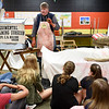 BEN MIKESELL | THE GOSHEN NEWS<br /> Surgeon reenactor Craig Malone explains how medics in the civil war would tend to soldiers in battle, during a presentation Friday morning at Northridge Middle School.
