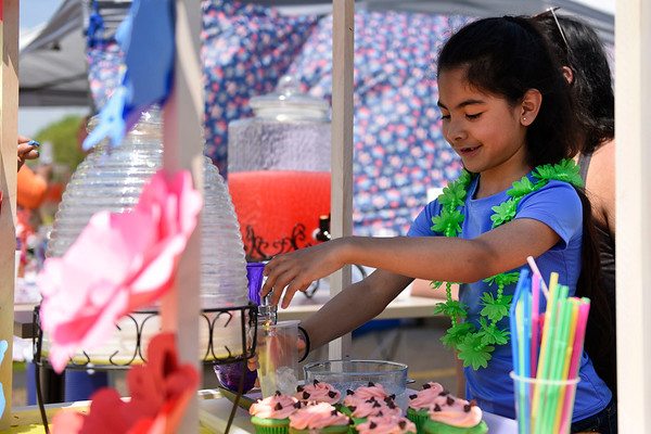 BEN MIKESELL | THE GOSHEN NEWS<br /> Emma Perez, 7, of Goshen, pours horchata into a cup during Saturday's Lemonade Day at Centier Bank. Perez wanted to put her own spin on Lemonade Day, serving up horchata and watermelon water, which are custom in Latino culture.