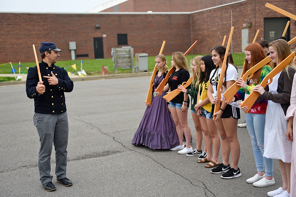 BEN MIKESELL | THE GOSHEN NEWS<br /> Social studies teacher Shawn Baker, left, explains proper marching techniques to a group of eighth-graders Friday morning during Civil War day activities at Northridge Middle School.
