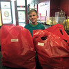 PHOTO CONTRIBUTED<br /> Owen Holmes, 9, of Goshen, stands with bags of popcorn ready to deliver for his ongoing fundraiser in the beginning of May inside Shirley's Gourmet Popcorn in Goshen. Holmes is raising money for his grandfather's heart transplant by going door-to-door with popcorn.