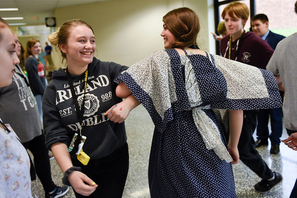 BEN MIKESELL | THE GOSHEN NEWS<br /> Eighth-grader Heather McBride, left, dances with classmate Jadeyn Stouder while participating in a Virginia reel dance Friday morning at Northridge Middle School.