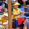 BEN MIKESELL | THE GOSHEN NEWS<br /> Marlee Nagle, 5, of Mishawaka, carries a cup of lemonade while he sister Reese, 3, left, grabs a cookie while they operate their lemonade stand Saturday afternoon at Centier Bank in Goshen.