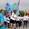 BEN MIKESELL | THE GOSHEN NEWS<br /> Runners in ADEC's 5k Color Run throw powder in the air at the start of the race Saturday morning at Northridge High School.