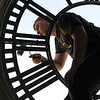 BEN MIKESELL | THE GOSHEN NEWS<br /> Jordon Blythe, with Smith's Bell and Clock Services, puts primer on the frame of the clock face Wednesday morning at the Elkhart County Courthouse.
