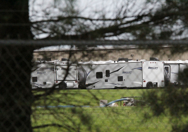 AIMEE AMBROSE | THE GOSHEN NEWS <br /> Pumps can be seen at the apparent site of a retention pond outside a Keystone RV plant, 2769 Elders Drive, in Goshen. Manuel Munoz Diaz of Hammond was found dead in the pond Monday, according to Goshen police.