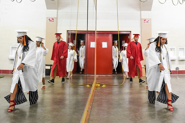 BEN MIKESELL | THE GOSHEN NEWS<br /> Graduating seniors walk through the wrestling practice area above the gym Thursday evening at Westview Jr. - Sr. High School.