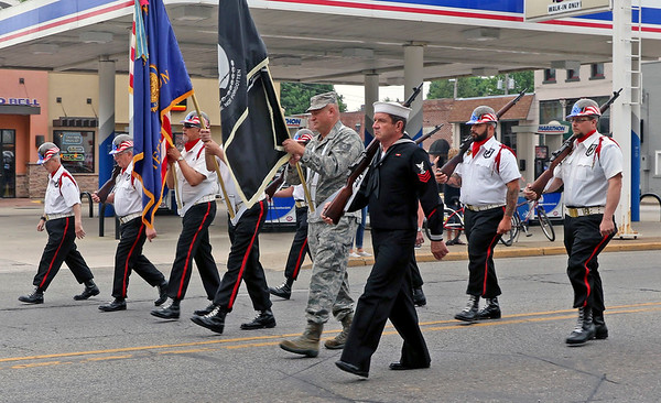 JOHN KLINE | THE GOSHEN NEWS<br /> Members of the Middlebury American Legion Post 210 Honor Guard lead the annual Memorial Day parade along Main Street in downtown Middlebury Monday morning.