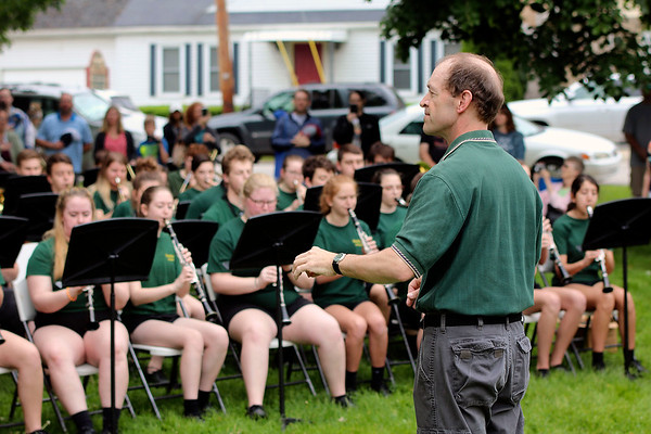 JOHN KLINE | THE GOSHEN NEWS<br /> Northridge High School Band Director Brad Zook, right, leads the school band in a medley of service branch songs during the Memorial Day service at Memorial Park in downtown Middlebury Monday morning.