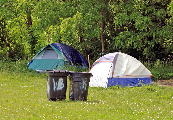 Roger Schneider | The Goshen News<br /> These two tents were among 18 that were visable along the west side of the Goshen millrace Friday afternoon. The campers are facing an eviction by city officials Monday.