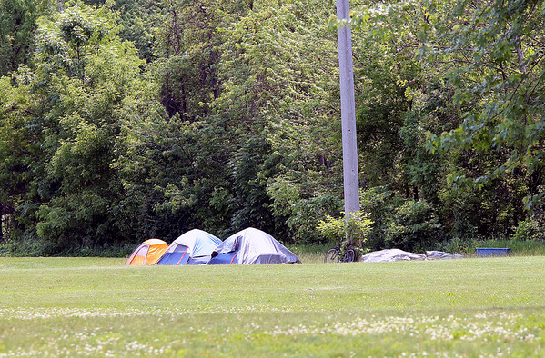 Roger Schneider | The Goshen News<br /> <br /> These three standing tents, and one collapsed tent, were located on the west side of the Goshen millrace Friday afternoon. The location has become a camp for homeless people.