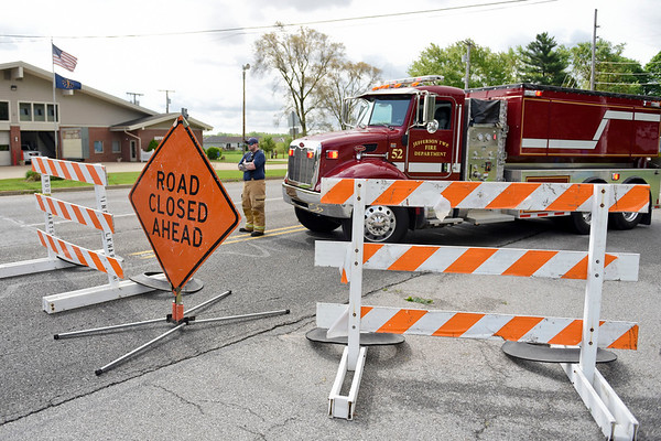 BEN MIKESELL   THE GOSHEN NEWS<br /> Jefferson Township firefighters close off Ind. 15 southbound at the intersection of C.R. 20 due to a downed tree Thursday morning.