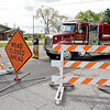 BEN MIKESELL | THE GOSHEN NEWS<br /> Jefferson Township firefighters close off Ind. 15 southbound at the intersection of C.R. 20 due to a downed tree Thursday morning.