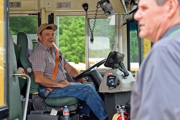 BEN MIKESELL   THE GOSHEN NEWS<br /> Concord Community Schools bus driver Lynn Loucks laughs with assistant superintendent Scott Kovatch after finishing the obstacle course during the school bus rodeo Tuesday at Concord Junior High.