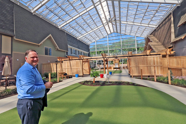 Roger Schneider | The Goshen News<br /> Hubbard Hill CEO Patrick Pingel stands in the atrium at the new Living Wisdom Community. The new dementia-care facility will open Monday.