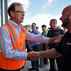 BEN MIKESELL | THE GOSHEN NEWS<br /> U.S. Senator Mike Braun shakes hands with plant manager Mike Bontrager during a tour of Grand Design RV's Solitude line Wednesday afternoon in Middlebury.