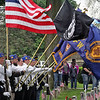 Roger Schneider | The Goshen News<br /> Members of the color guard hold a variety of flags at Oakridge Cemetery in Goshen during Memorial Day services.