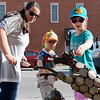 BEN MIKESELL | THE GOSHEN NEWS<br /> Maggie Carr, left, Nappanee, helps her kids Conley, 4, center, and Cadee, 6, point out different metal objects making up a dog sculpture Wednesday evening in downtown Nappanee.
