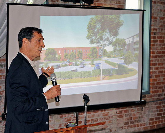JOHN KLINE | THE GOSHEN NEWS<br /> Mishawaka-based architect Scott Sivan discusses the three multi-million dollar projects his firm, Insite Development, is currently developing along Goshen's millrace during the Wake Up, Goshen luncheon at Bread & Chocolate in The Old Bag Factory Wednesday afternoon.