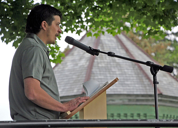 Roger Schneider   The Goshen News<br /> As a breeze ruffles his notes, Harold Eichhorn, of Goshen, a veteran of two foreign deployments with the National Guard, speaks at the Goshen Memorial Day service Monday morning.
