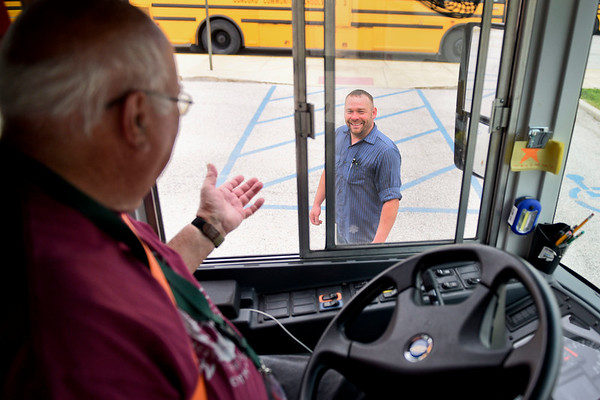 BEN MIKESELL | THE GOSHEN NEWS<br /> Concord Community Schools bus driver Jerry Perry, left, laughs with mechanic Tony Crowder before taking on the obstacle course during the school bus rodeo Tuesday at Concord Junior High.