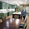 Roger Schneider | The Goshen News<br /> Debbie Carriveau executive director of the Living Wisdom Center, stands in the kitchen/dinning area of one of four households. Residents and staff will make meals together and eat togethr at the new facility.