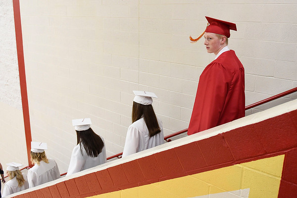 BEN MIKESELL | THE GOSHEN NEWS<br /> Senior Christopher Anderson walks down the stairs to the graduation ceremony Thursday evening at Westview Jr. - Sr. High School.