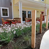Roger Schneider | The Goshen News<br /> Flowers line a walkway near a patio in the atrium at the Hubbard Hill Living Wisdom Community.